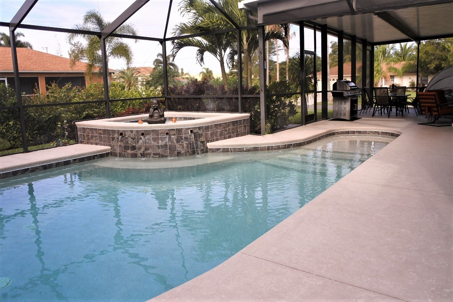 private and screened pool area (saltwater pool) with hot tub